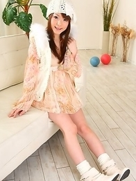 Hot babe Fuwari poses on the couch