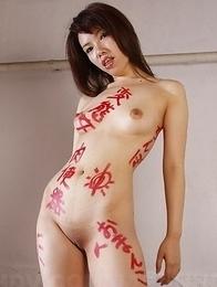 Nude Remi Kawamura poses on set