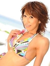 Hot girl does photo shoot on beach