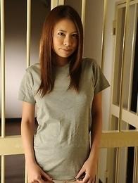 Sexy prisoner displays her boobs