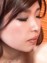 Ai Okada Asian touches dick with feet in stockings and sucks cock