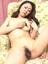 Ruri Hayami Asian arouses dark hairy pussy and clit with vibrator