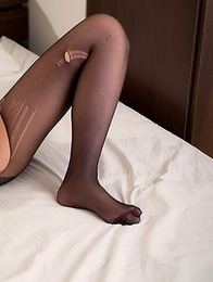 Whorish hottie Mizuho Shiina posing in pantyhose and teasing with her pussy