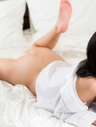 Brunette with bangs Luna Kobayashi shows her delicious pussy on a white bed