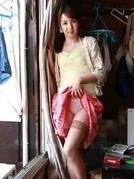 Asian Chika Sasaki strips to show round boobs