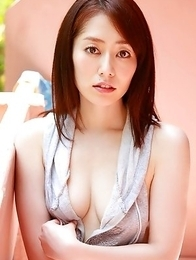 Momoko Tani in blue bath suit sits with ass up at the pool