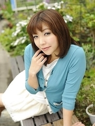 Juri Kitahara in blue sweater and lace skirt