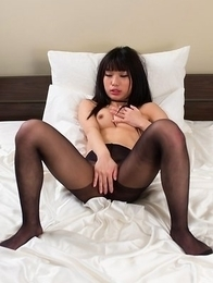 Leggy Luna Kobayashi puts on a sexy pantyhose before using her vibrator toy