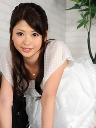 Hitomi Nose is playful doll in short jeans and high heels