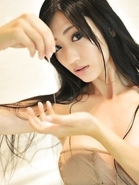 Mitsu Dan with long hair examines hot behind in the mirror