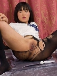 Pantyhose-clad hottie Uta Kohaku using her vibrator to cum buckets on cam