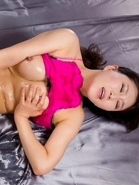 Oiled-up seductress Yuu Kazuki teasing her leaking pussy with a vibrator