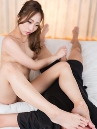 Leggy brunette Juri Kisaragi flashes her pussy with her legs spread on the floor