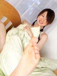 Naoko Sawano in swimsuit puts pillow between her sexy legs