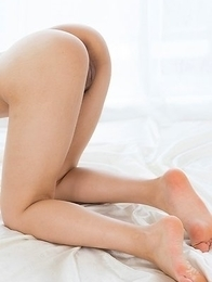Teenage tomboy Ai Mukai takes off her bikini to masturbate and show feet