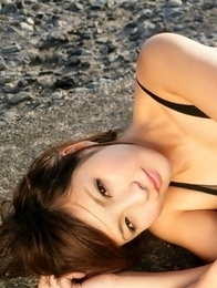 Rina Nagasaki in see through lingerie shows legs on rocks