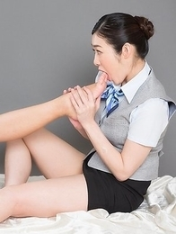 Uniformed beauties Reiko Kobayakawa and Ryu Enami worship each other's feet