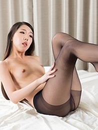 Pantyhose-clad babe Rio Kamimoto fingers herself and poses showing her bush
