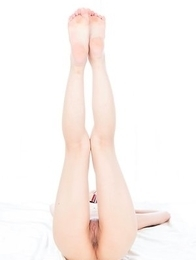Long-legged babe Aki Tojo flashes pussy and does all sorts of naughty stuff