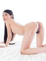 Oily Rio Kamimoto assumes the position on all fours before giving a great assjob