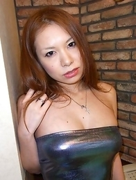 Hiromi exposes her pair of big boobies while she gets her pussy worked over with a vibrator