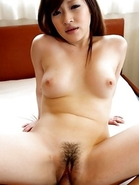 Beautiful Japanese Yukina Mori uses her big titties to work a cock and rides it